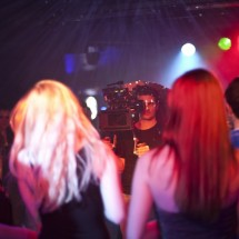 Nino Leitner shooting the music video among the dancers in the club