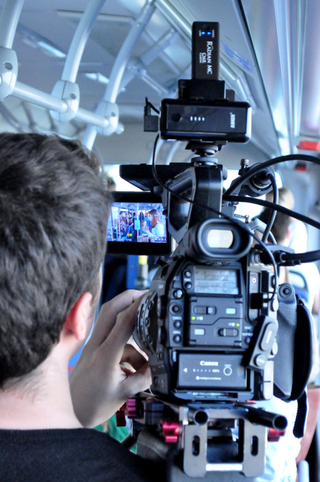 Me shooting a commercial on a moving (hired) bus - with the client sitting within the frame, back to camera, while watching the video through the wireless connection with the Radian MC :-)